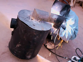 Welding Rocket Stove Space Heater from Recycled Steel Parts